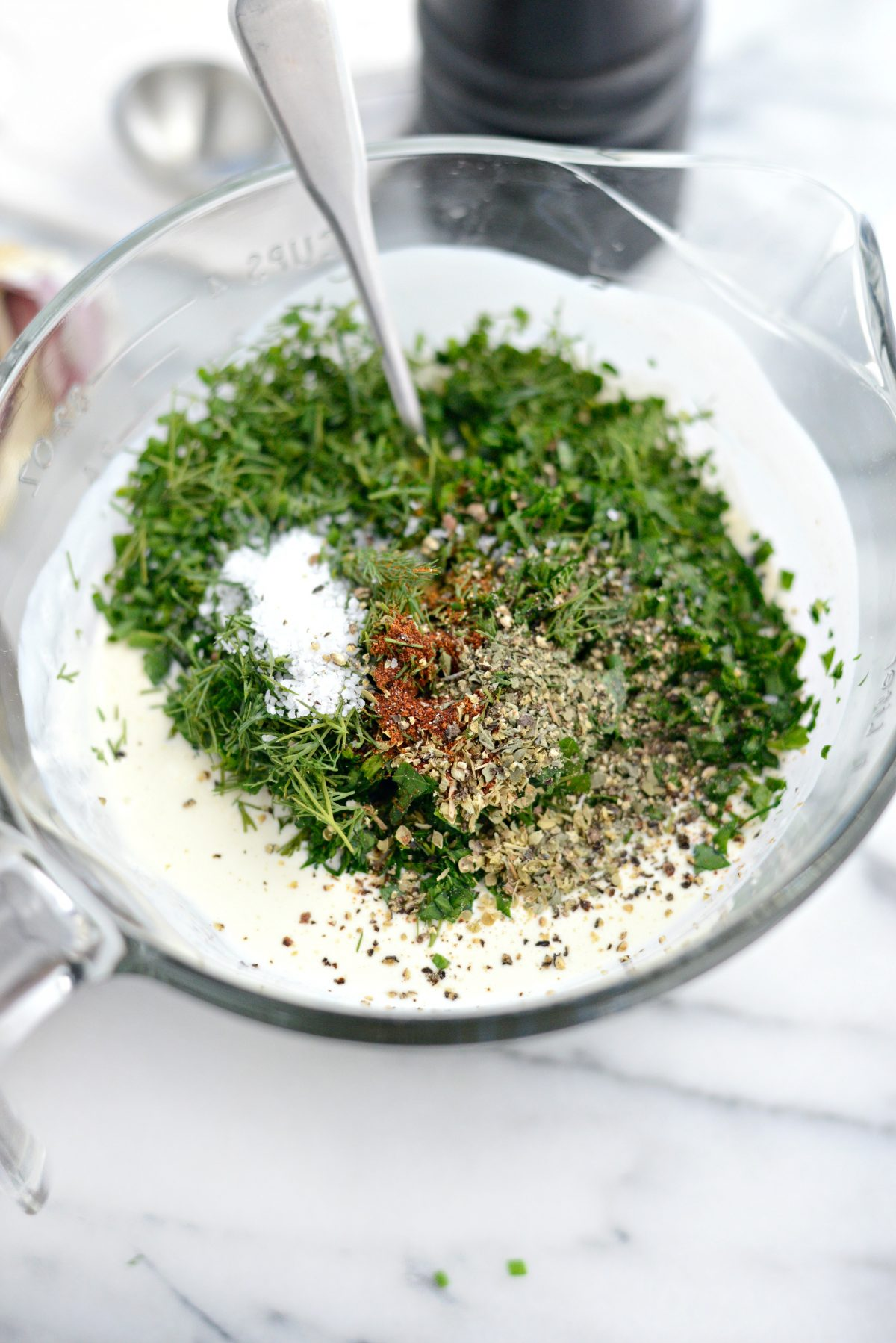 Add fresh herbs and dried spices to dressing