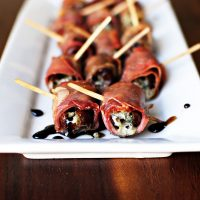 Prosciutto Wrapped, Gorgonzola Stuffed Dates with Honey-Balsamic Drizzle
