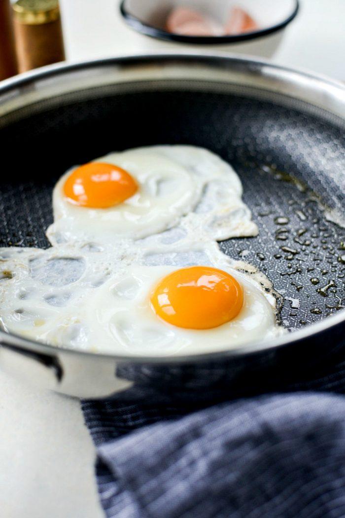 frying eggs in skillet