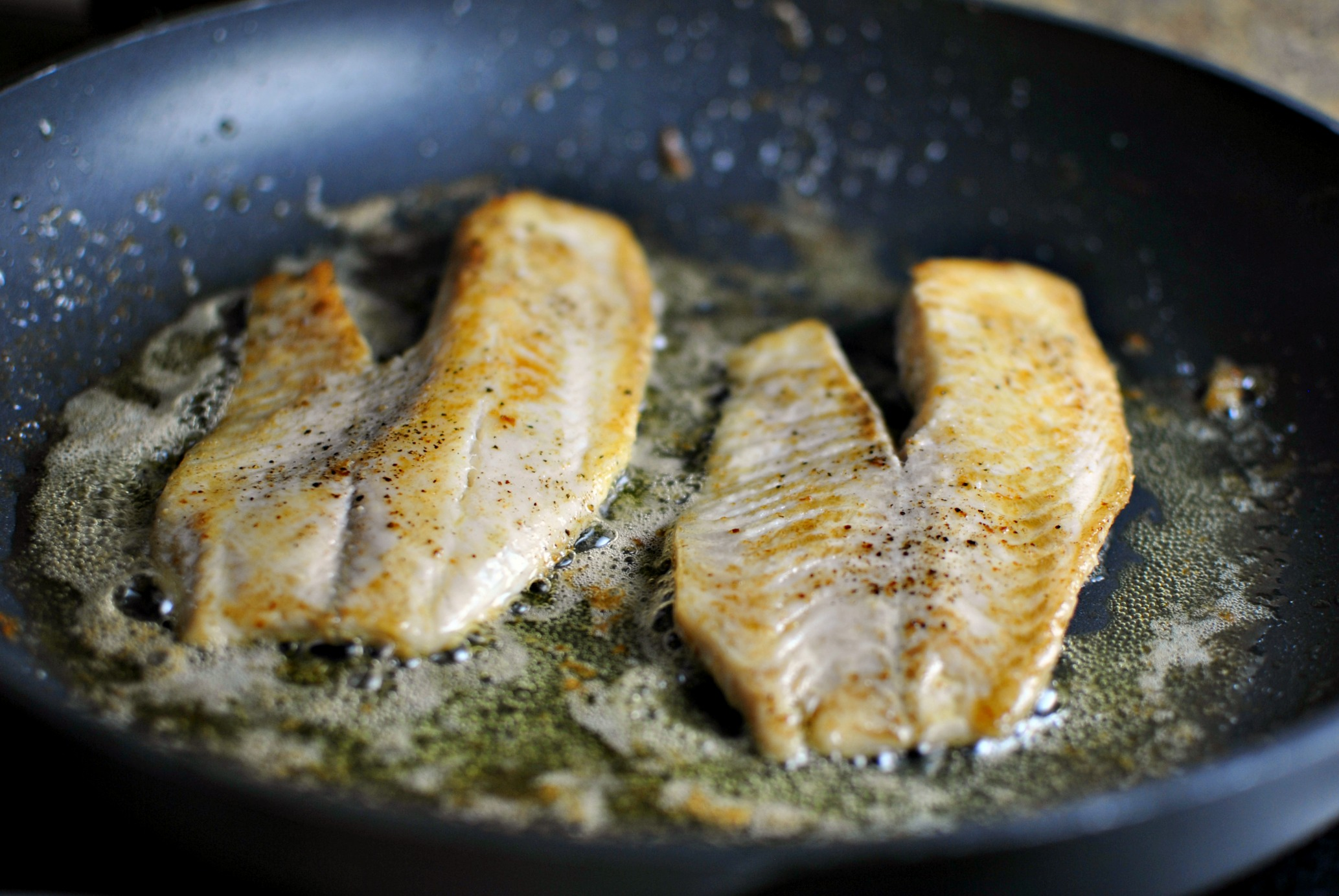 Simply scratch tilapia with lemon caper sauce simply scratch for How to bake tilapia fish