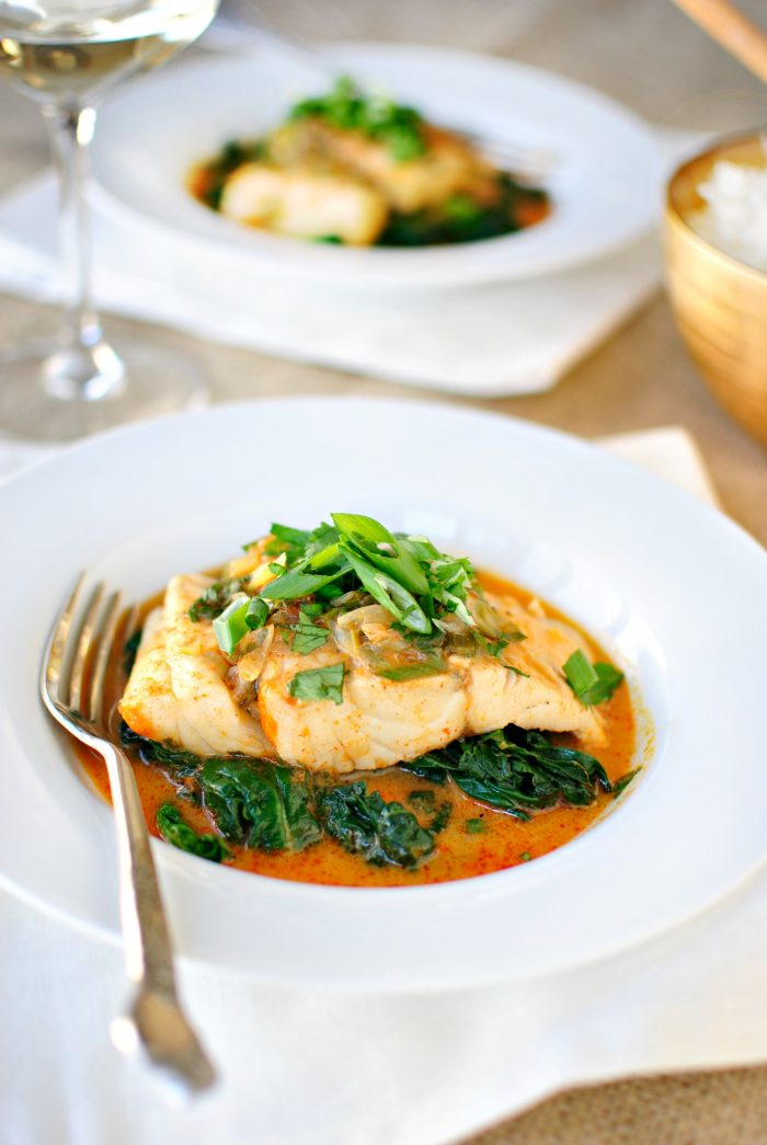 Thai Coconut Curry Poached Barramundi with green onions on top