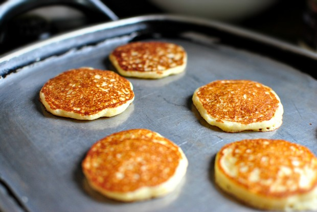Toasted Cornmeal Pancakes and Honey Butter Maple Syrup l www.SimplyScratch.com continue to cook