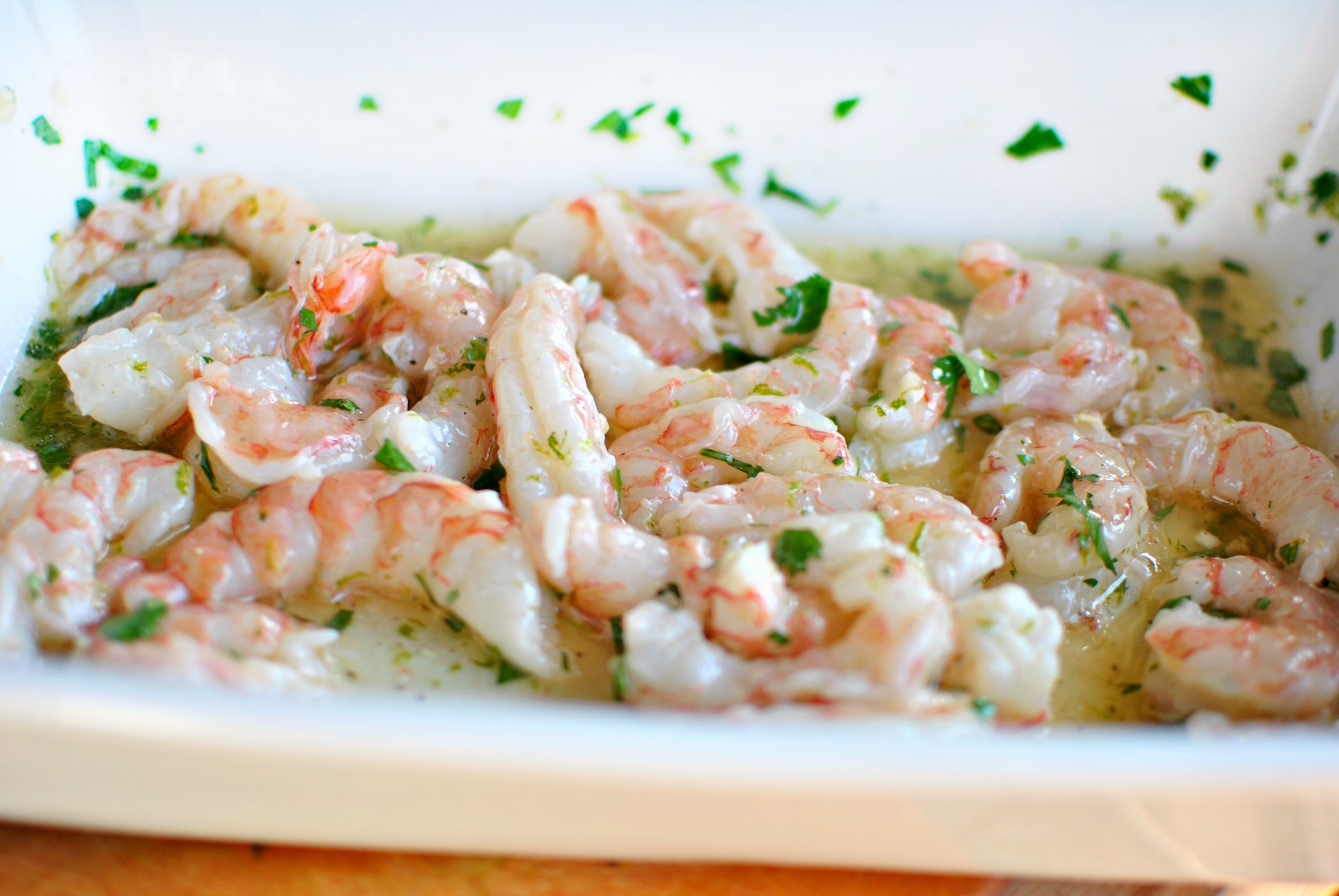 Toss the shrimp and toss them in the garlic lime goodness and let them ...