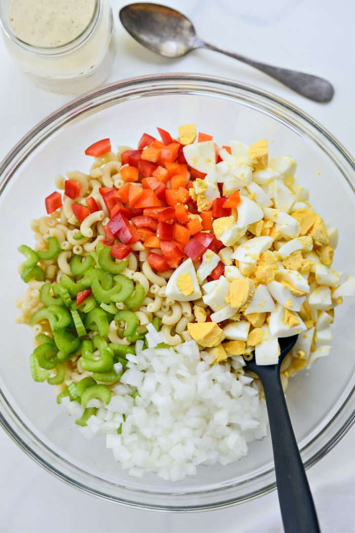 pasta, egg, peppers, onions and celery in a large bowl.