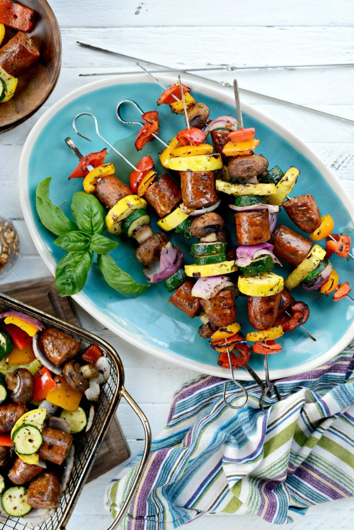 chicken sausage vegetable kebabs on turquoise platter