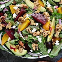 Roasted Beet Salad with Avocado, Goat Cheese and Candied Walnuts with Honey Dijon Vinaigrette