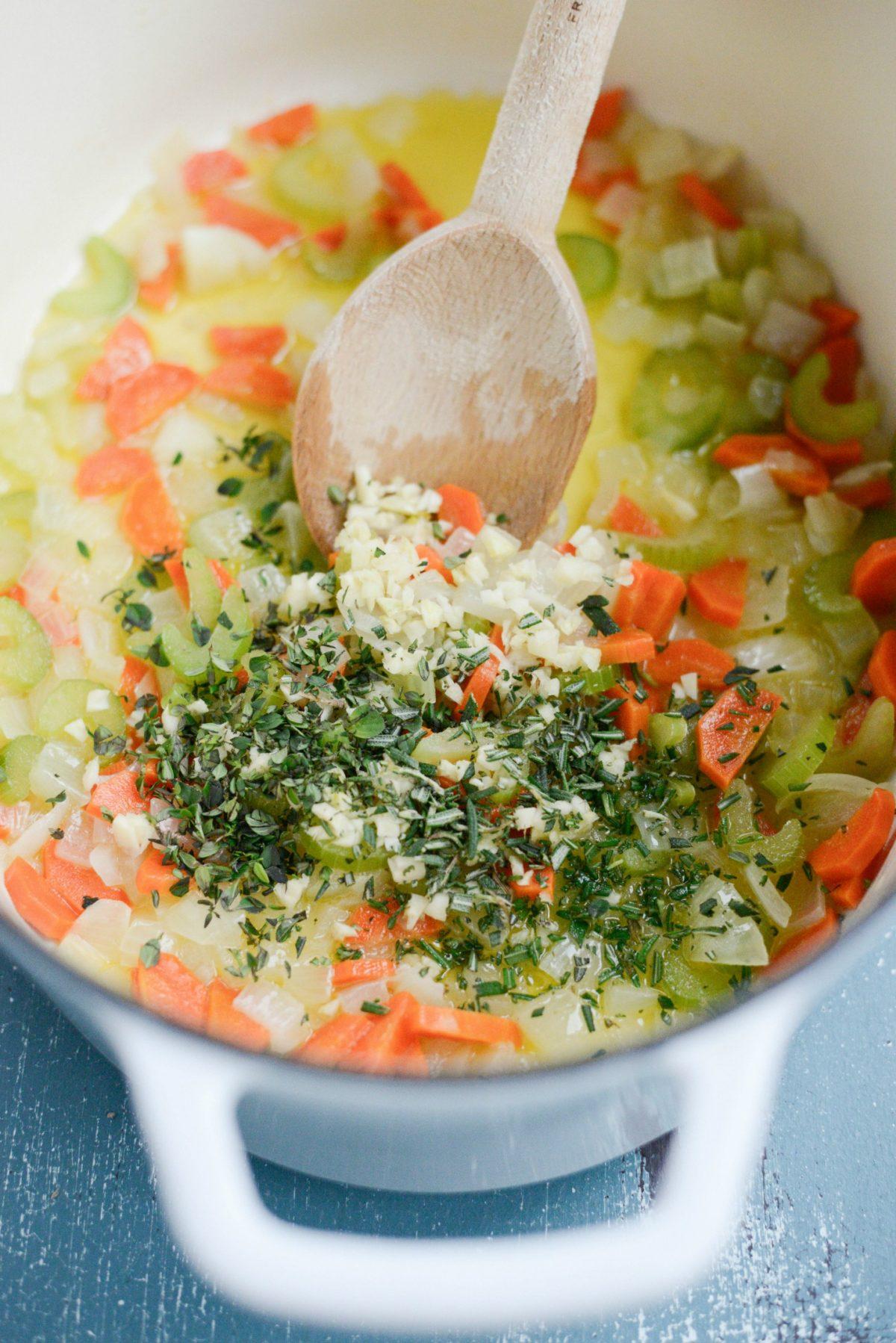 garlic and herbs added to sautéed veggies.