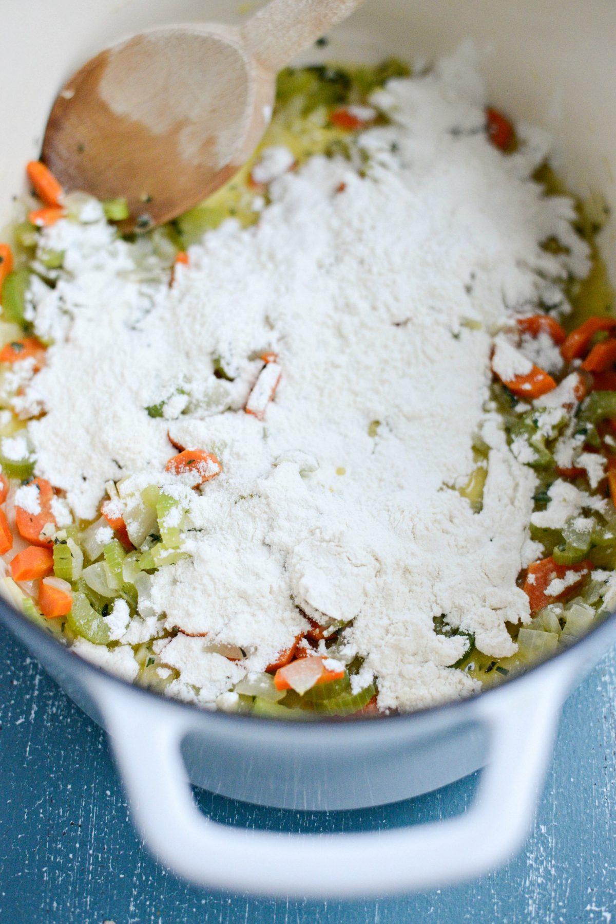 flour sprinkled over sautéed veggies and herbs.