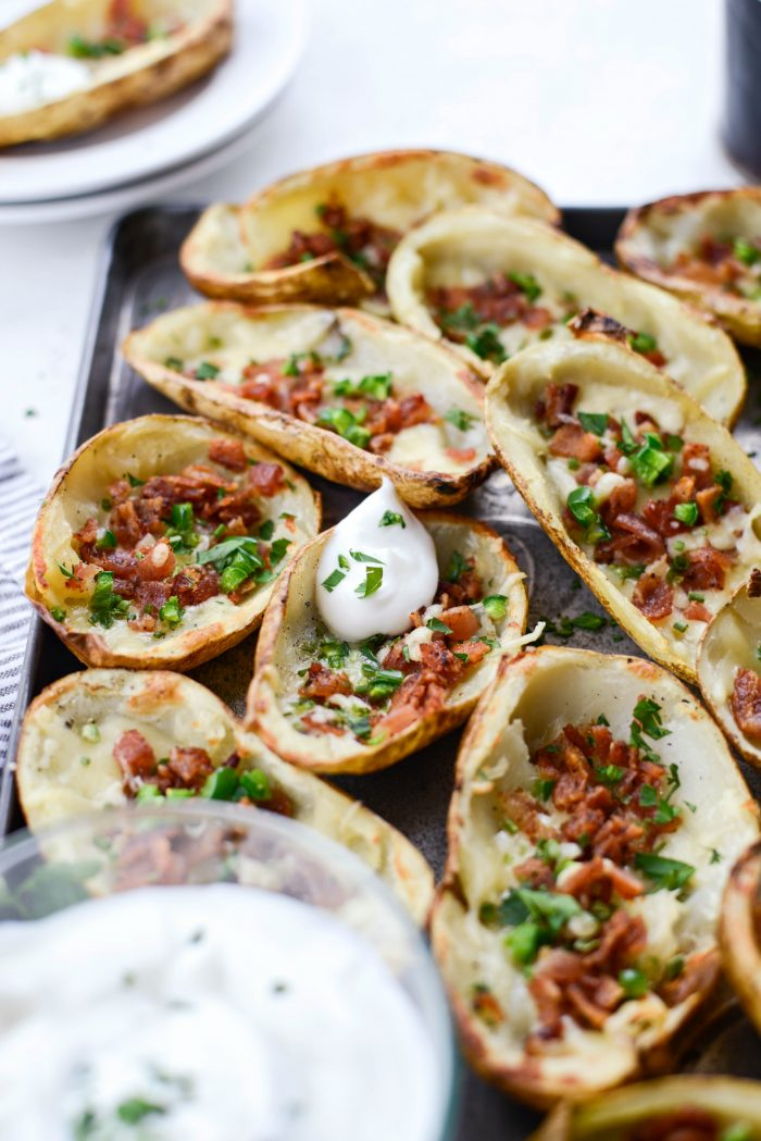 Irish Cheddar Bacon Jalapeño Potato Skins with sour cream and chives