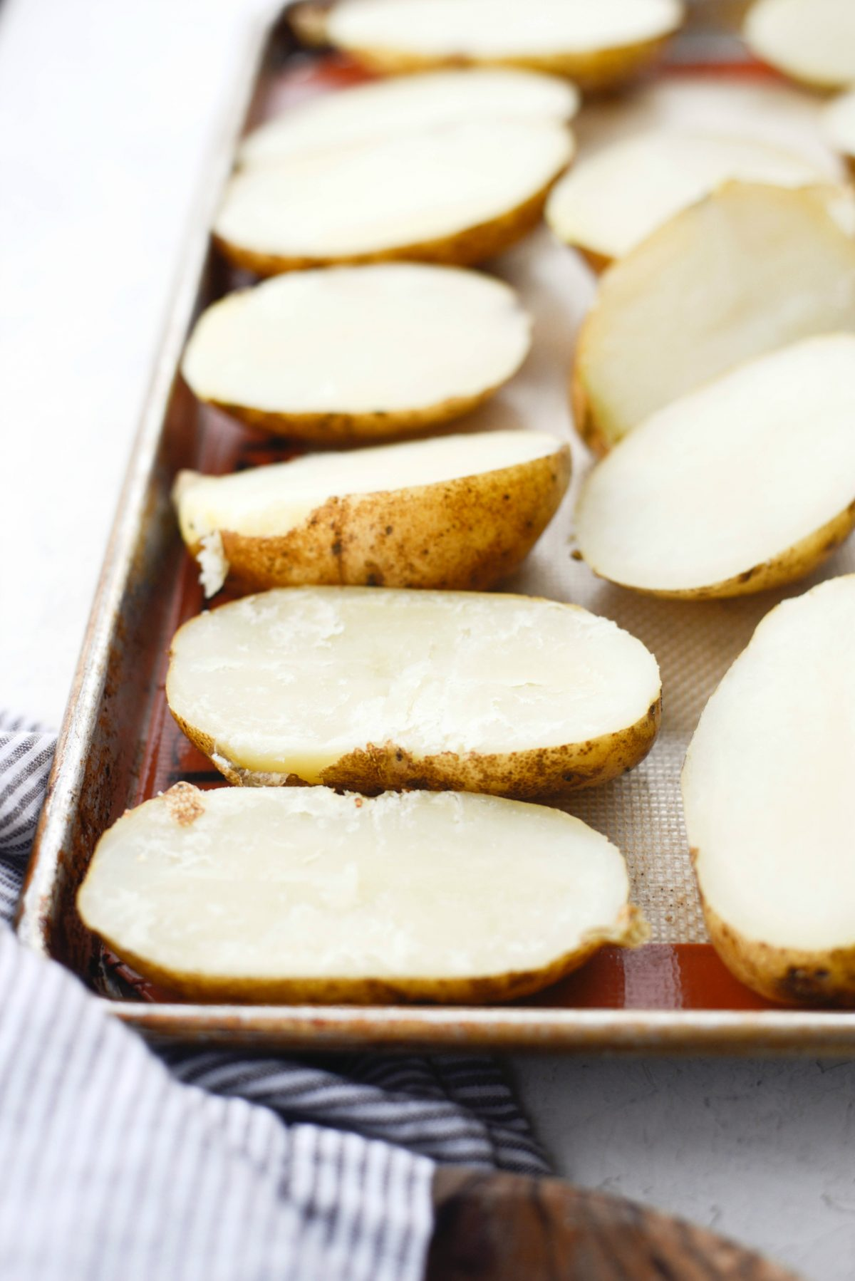 halved potatoes on a sheet pan