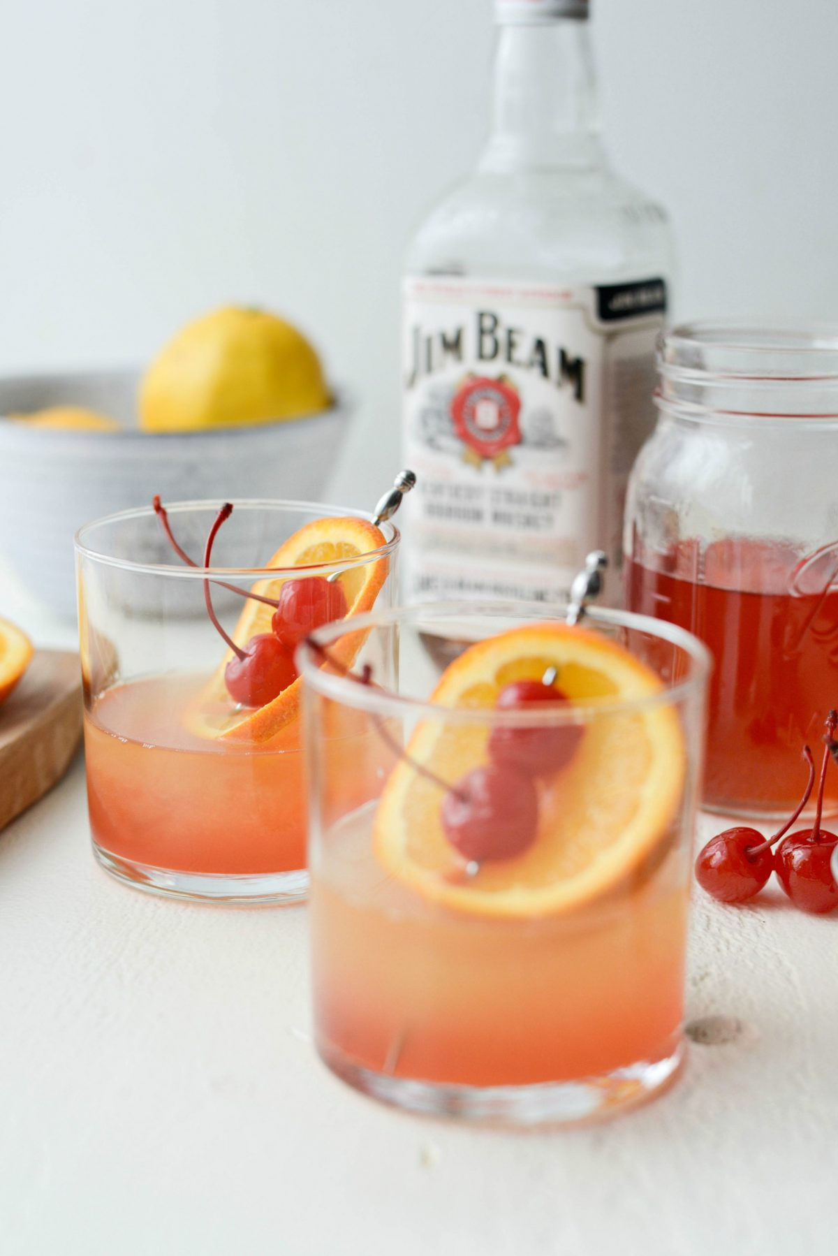 Whiskey Sour Sunrise l SimplyScratch.com #whiskey #lemon #cherry #adultbeverage #whiskeysour #recipe #drink #beverage