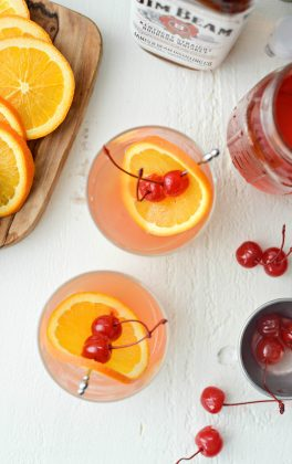 Whiskey Sour Sunrise l SimplyScratch.com #whiskey #lemon #cherry #adultbeverage #whiskeysour #recipe #drink #beverage