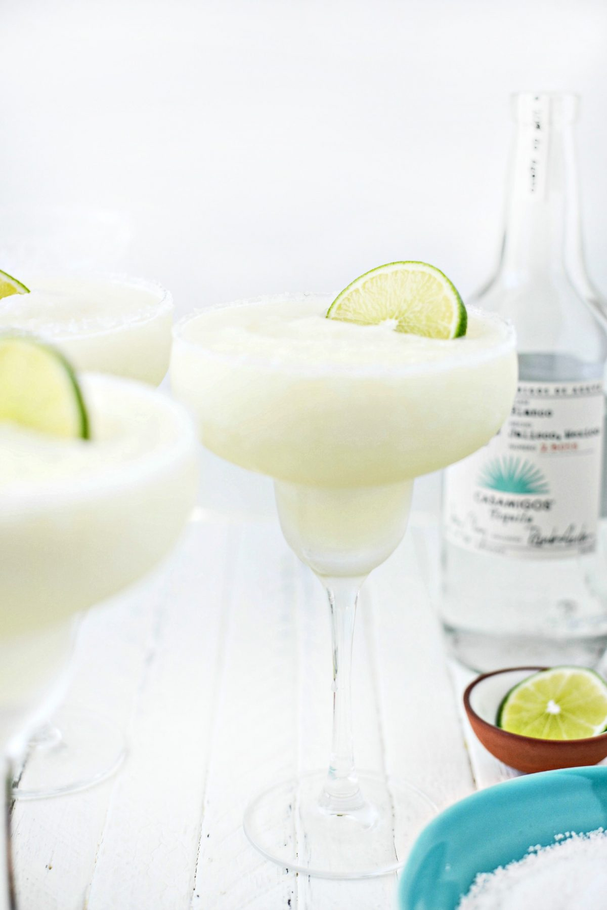 Frozen Margarita Slush with lime slice.