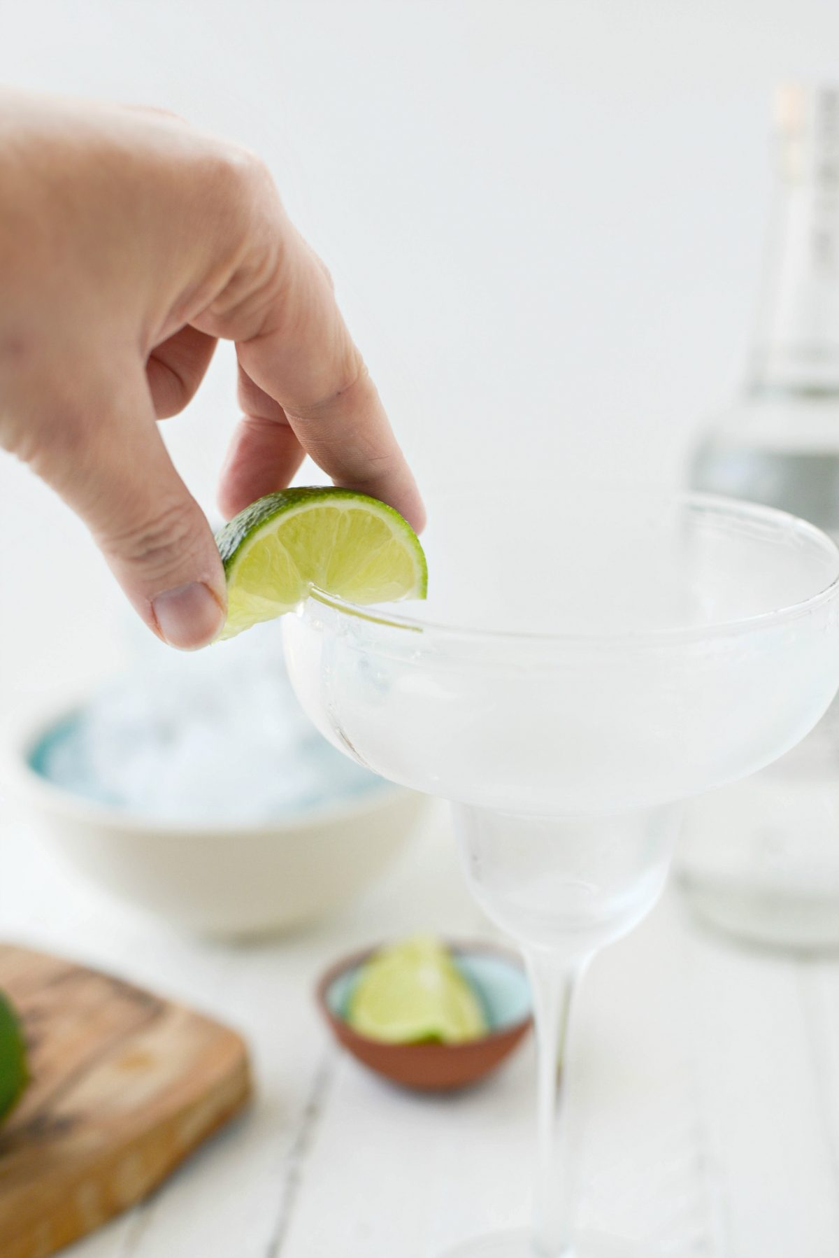 wet rim of glass with wedge of lime.