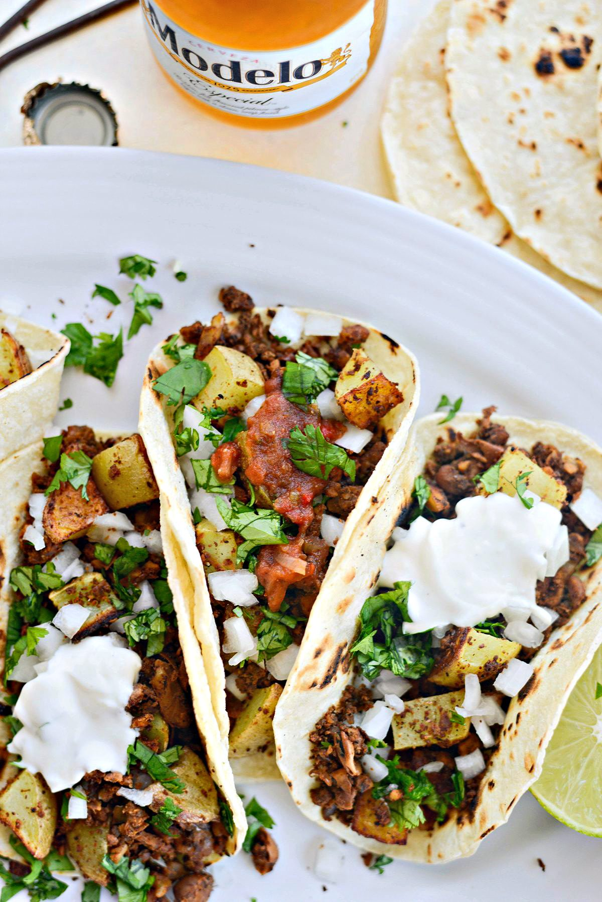 Vegan Chorizo and Crispy Potato Tacos l SimplyScratch.com with toppings