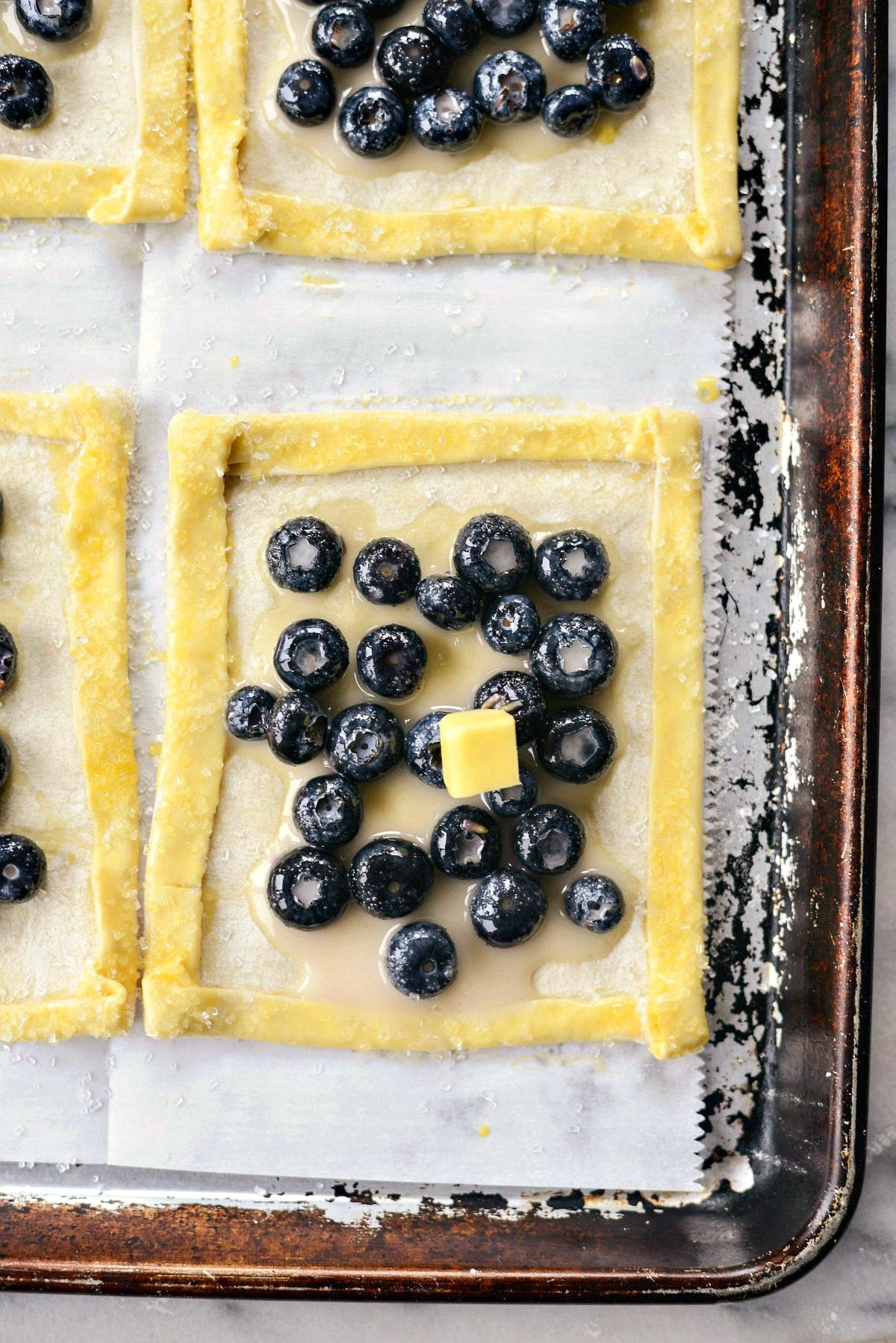 Blueberry Lavender Pastry Pies l SimplyScratch.com #blueberry #lavender #puffpastry #pies #dessert