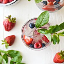 Red, White and Blue Sangria l SimplyScratch.com #adultbeverage #sangria #whitesangria #berries #wine #whitewine