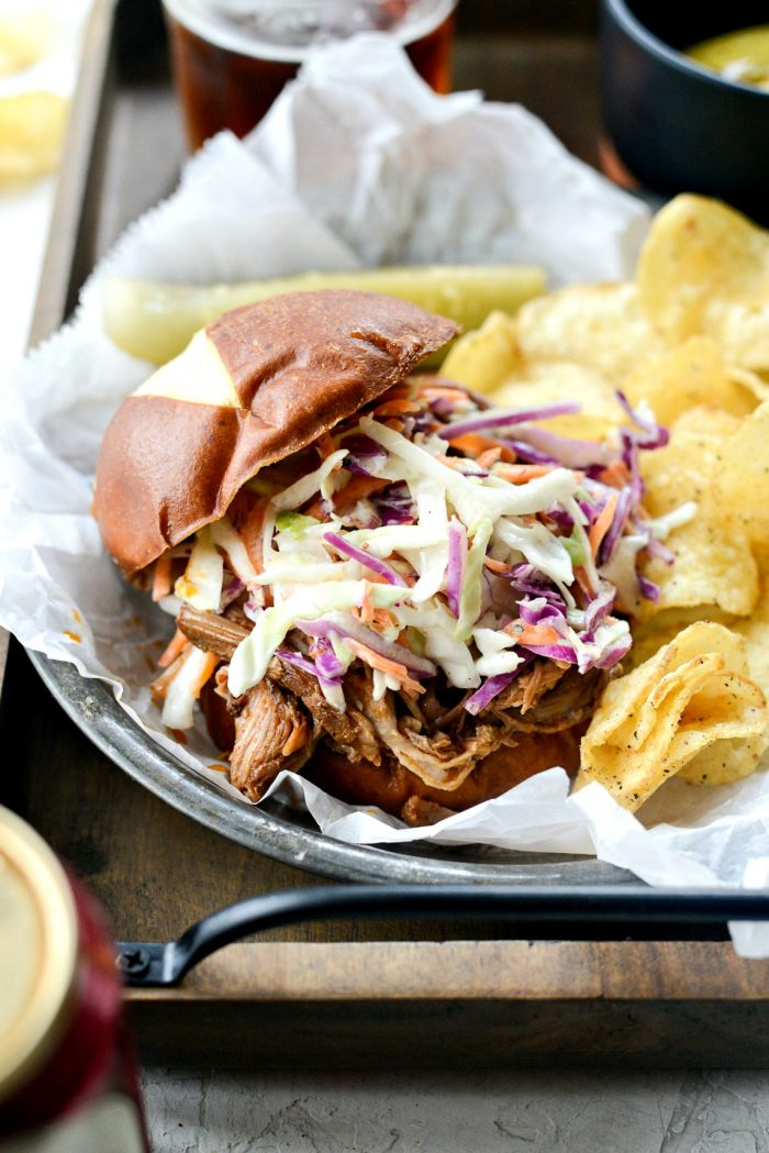 Slow Cooker Pulled Pork Sandwiches l SimplyScratch.com #pulledpork #slowcooker #pork #crockpot #easy