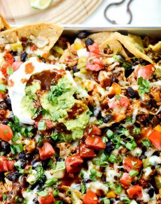 Deep Dish Black Bean Chicken Chorizo Nachos l SimplyScratch.com #blackbean #chicken #chorizo #nachos #easy #gameday #recipe #simplyscratch