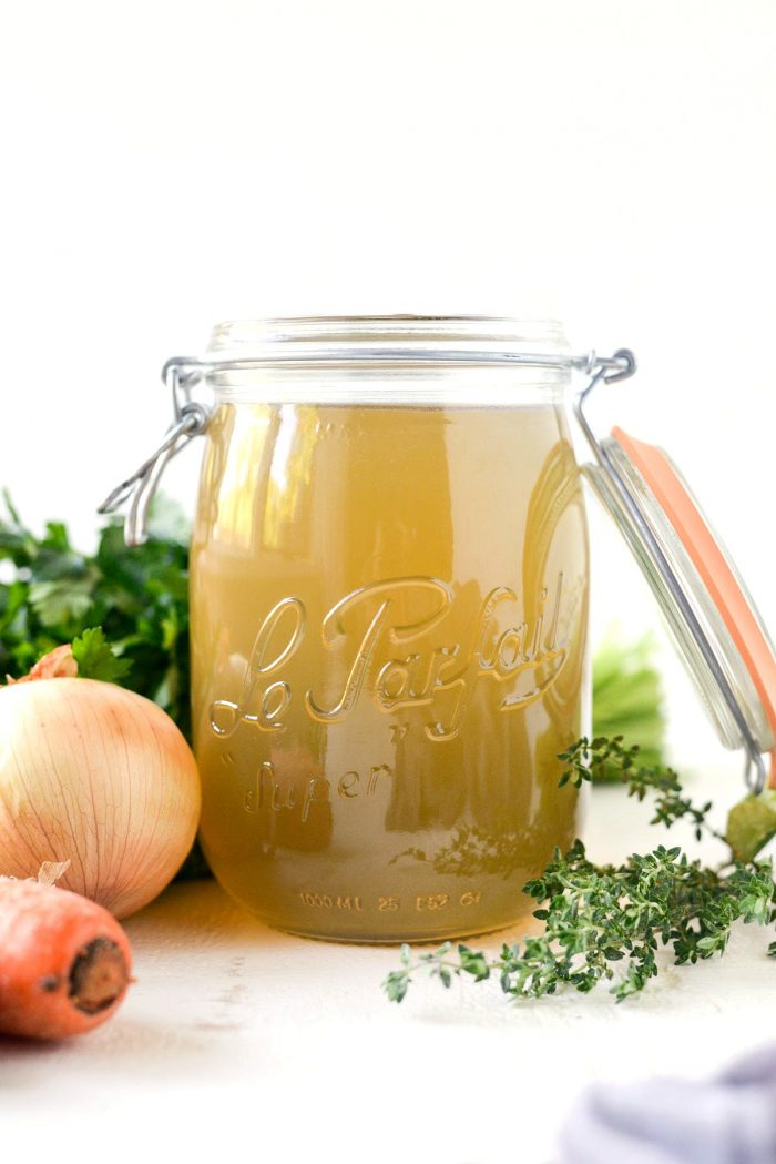 Slow Cooker Chicken Stock l SimplyScratch.com #homemade #fromscratch #slowcooker #chickenstock #chicken #simplyscratch