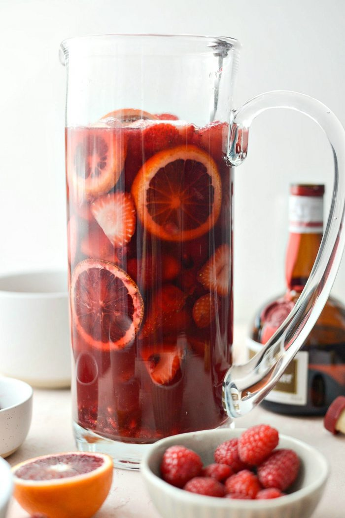 Champagne Sangria l SimplyScratch.com #champagne #sangria #valentinesday #adultbeverage #drink #alcholic #strawberry #pomegranate #raspberry #pitcherofsangria