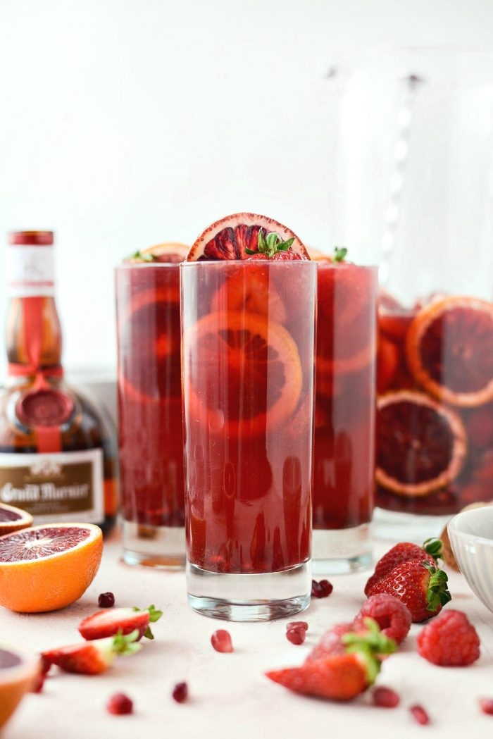 Champagne Sangria l SimplyScratch.com #champagne #sangria #valentinesday #adultbeverage #drink #alcholic #strawberry #pomegranate #raspberry #GalentinesDay