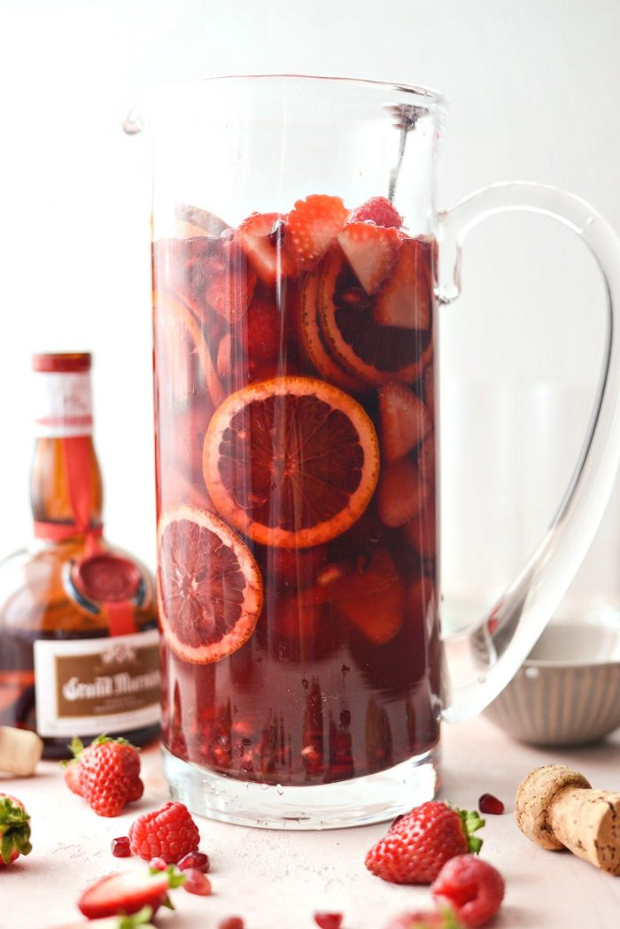 Champagne Sangria l SimplyScratch.com #champagne #sangria #valentinesday #adultbeverage #drink #alcholic #strawberry #pomegranate #raspberry