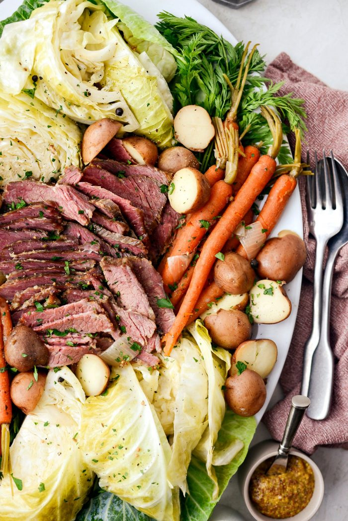 Slow Cooker Corned Beef and Cabbage Dinner l SimplyScratch.com #slowcooker #cornedbeef #stpatricksday #easydinner #crockpot #slowcooking #beef #boileddinner #irishdinner