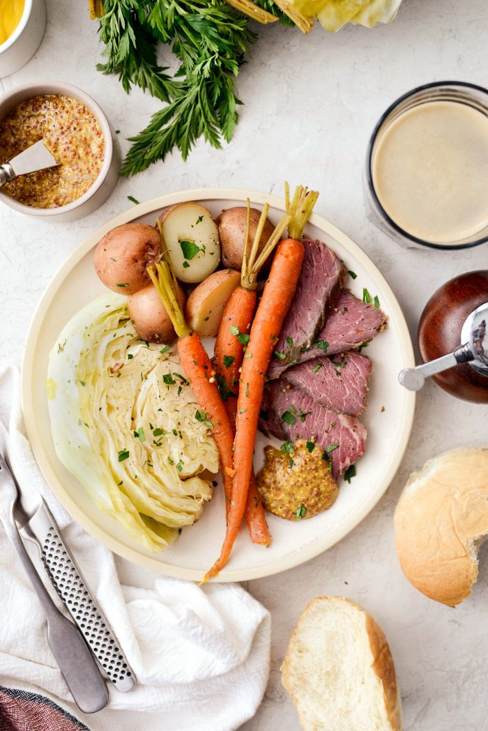 Slow Cooker Corned Beef and Cabbage Dinner l SimplyScratch.com #slowcooker #cornedbeef #stpatricksday #easydinner #crockpot #slowcooking #beef #boileddinner #irishdinner