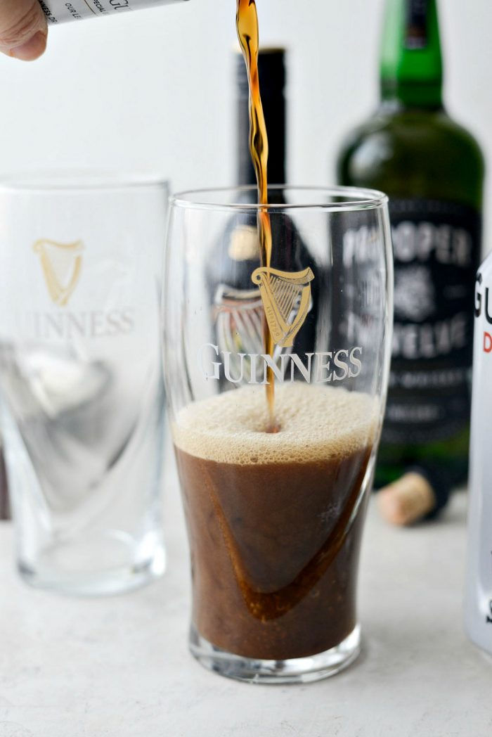 pouring Guinness into glass