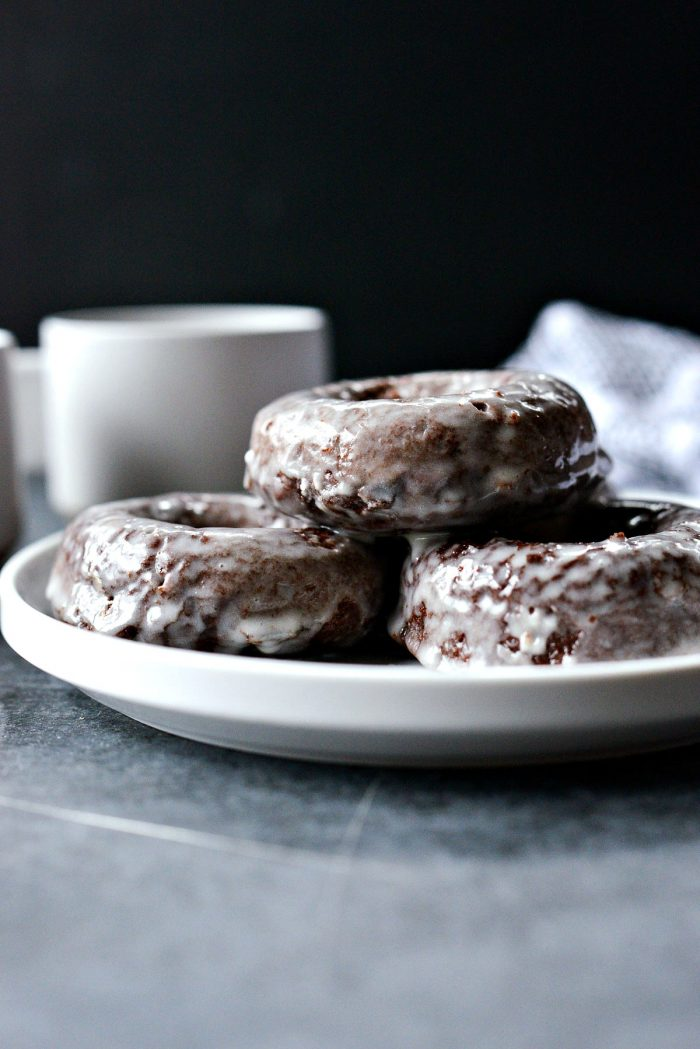 Glazed Chocolate Cake Doughnuts - stack of doughnuts