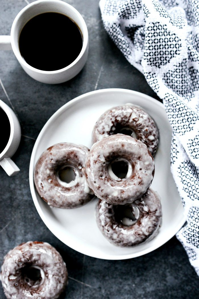 Glazed Chocolate Cake Doughnuts with 2 cups of coffee
