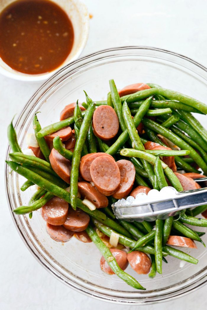 sausage, onion and green beans tossed with half the sauce.