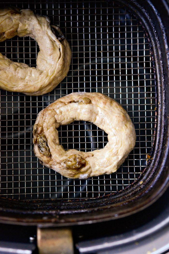 bagel placed in air fryer basket.