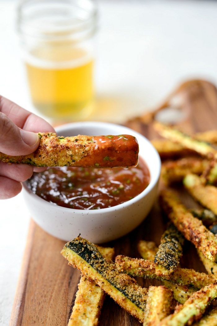 Air Fryer Zucchini Fries - close up of crispy air fryer zucchini fry with basil ketchup