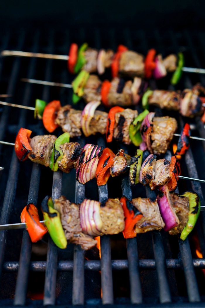 steak kebabs on grill with grill marks.