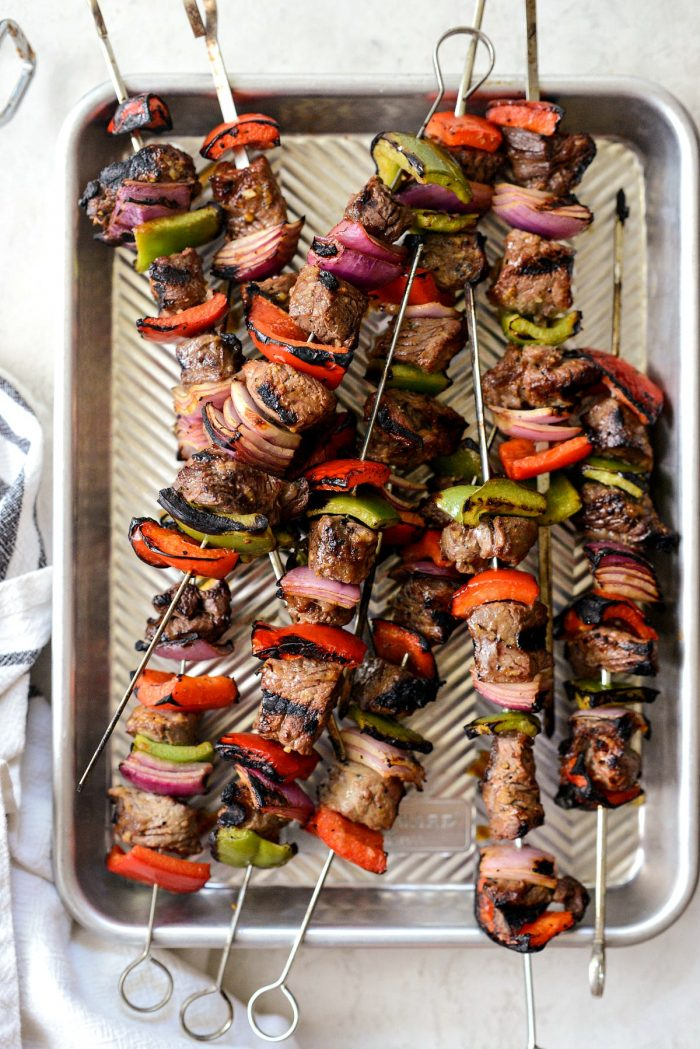 steak kebabs off of the grill and on metal pan.