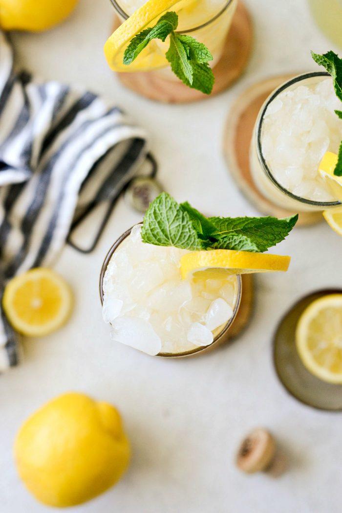 garnish lemon shandy refresher with lemon and mint
