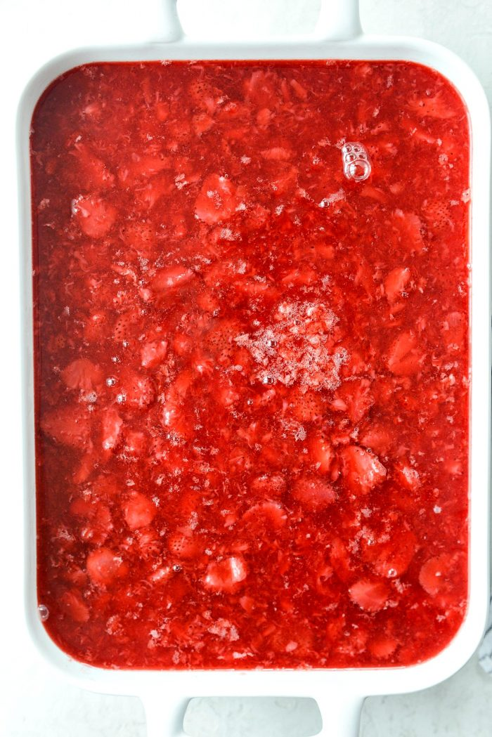 strawberry jell-o mixture poured over top of chilled cream cheese mixture.