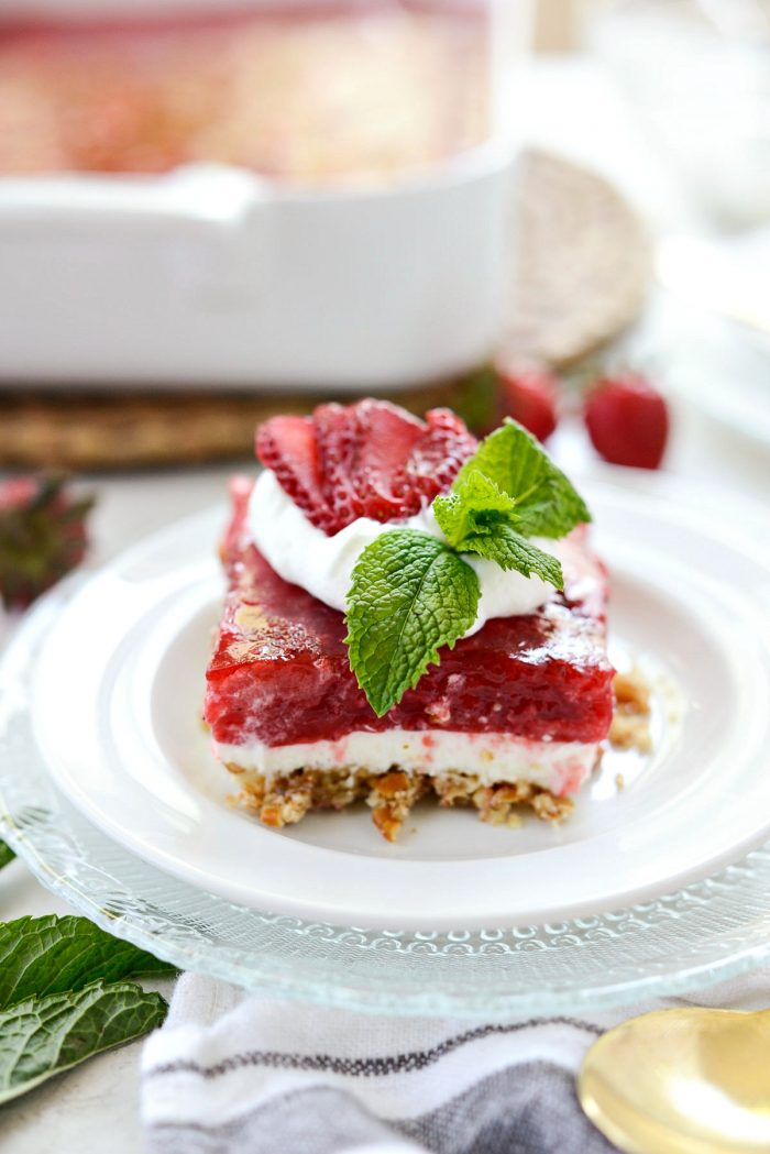 Front view of strawberry Pretzel Dessert Bars on white plate.