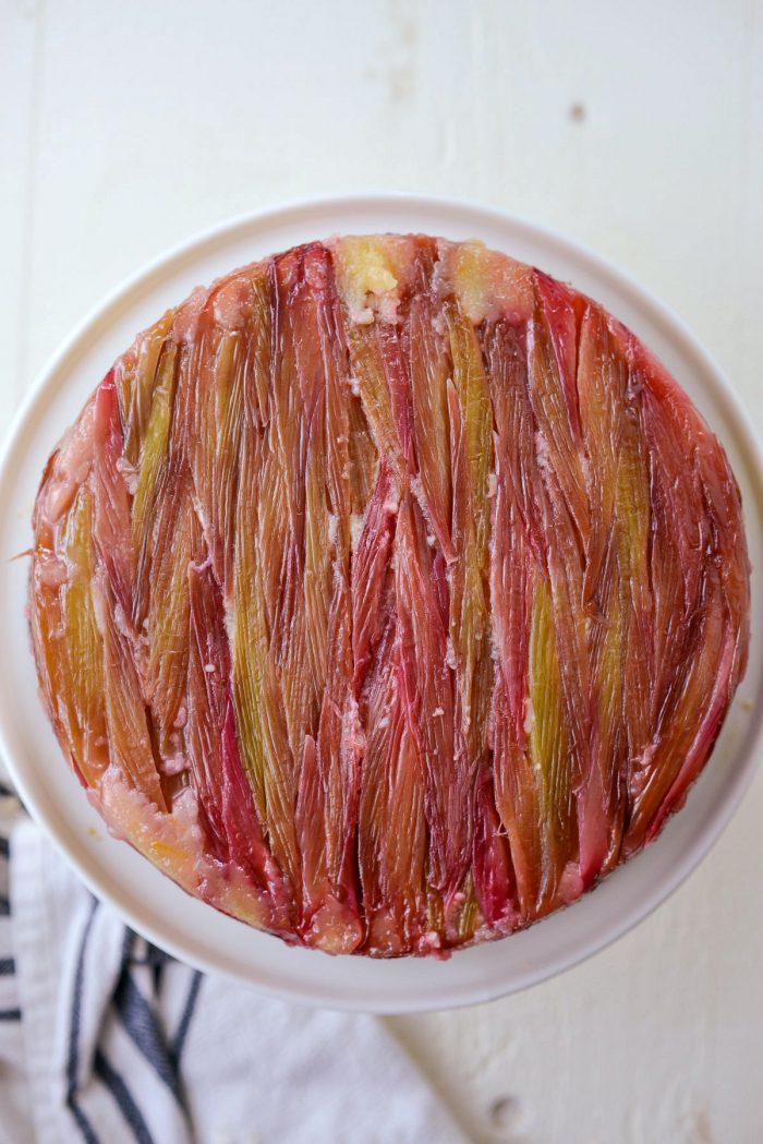 carefully invert Martha's Rhubarb Upside Down Cake onto stand and remove pan.