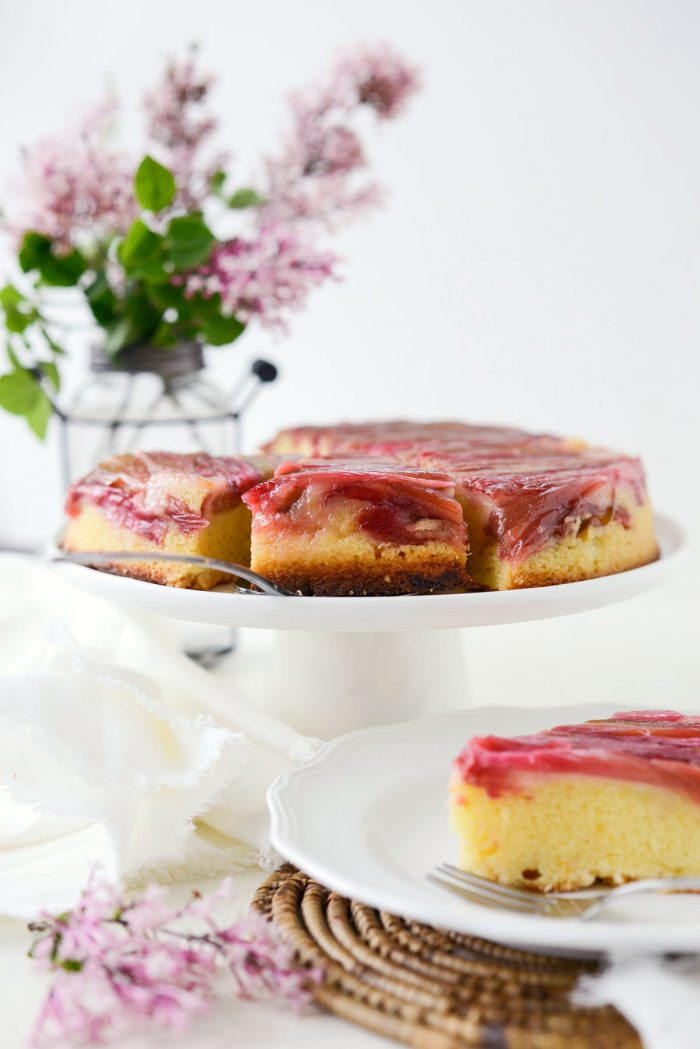 Martha's Rhubarb Upside Down Cake on white pedestal cake plate.