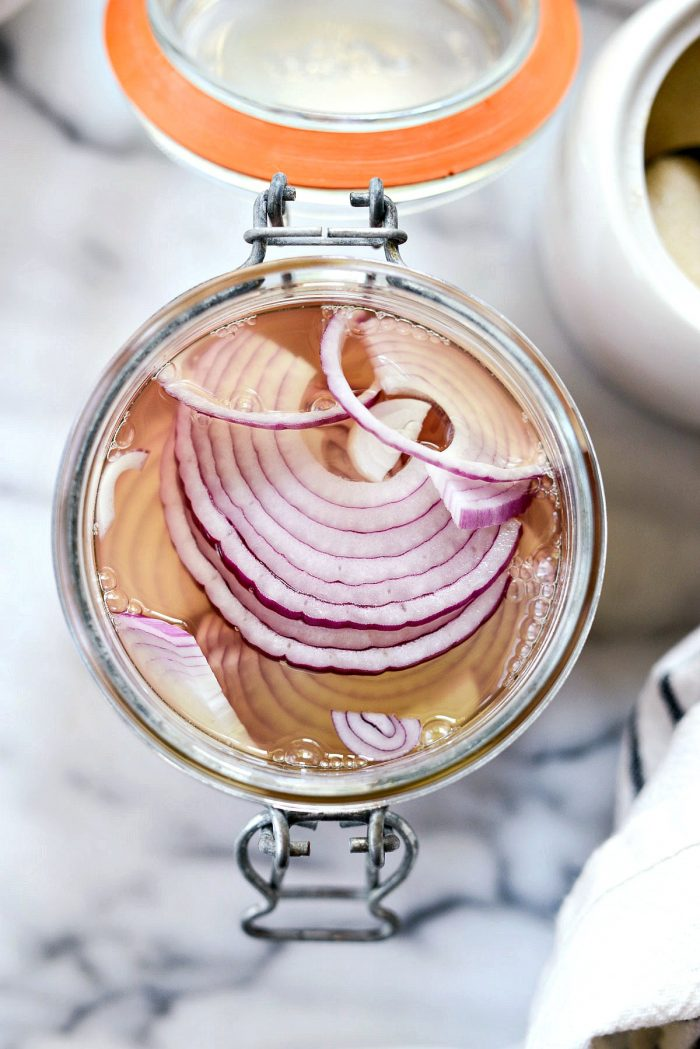 submerge the onions in the pickling liquids.