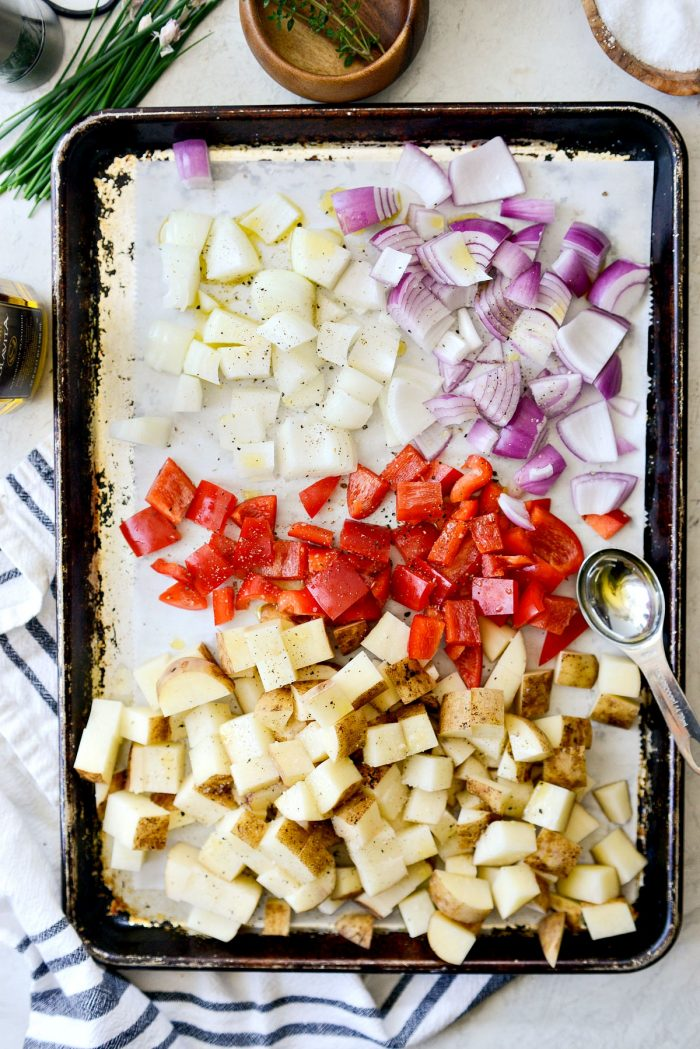 diced russets, red pepper and onions on a sheet pan.