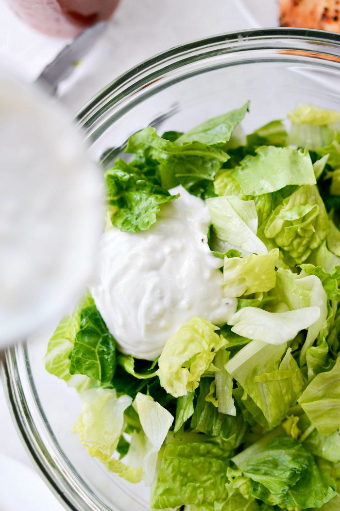 add some blue cheese dressing to salad greens.