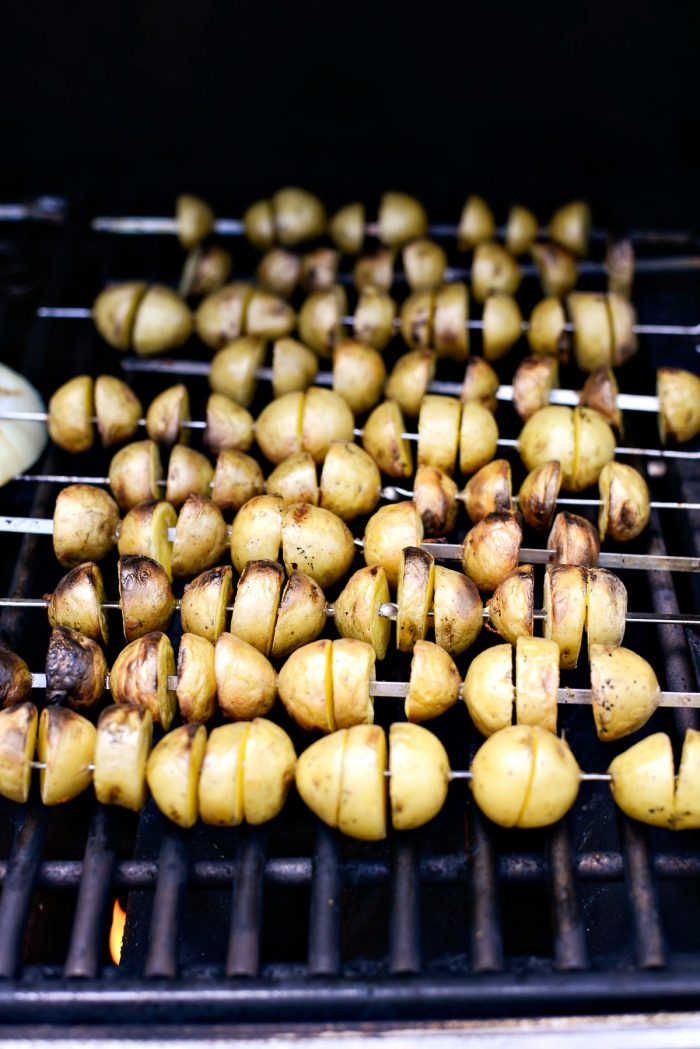 grilled potatoes on metal skewers