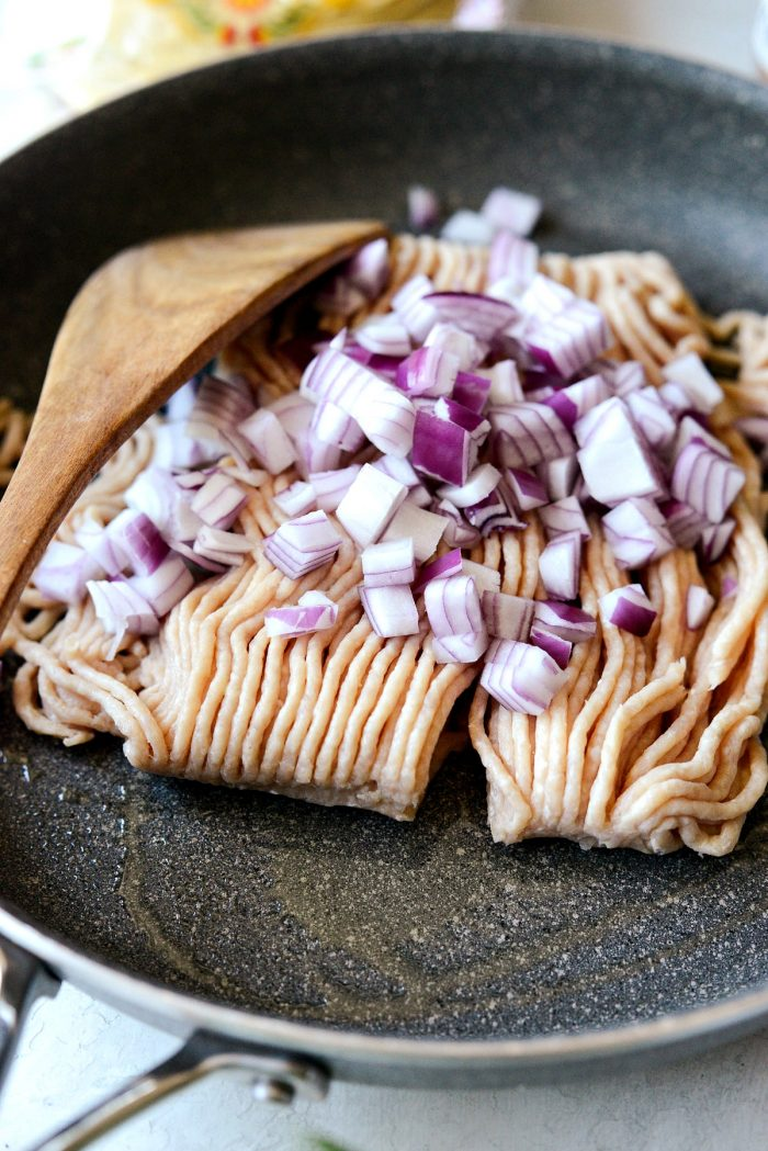 ground chicken and red onion in a skillet