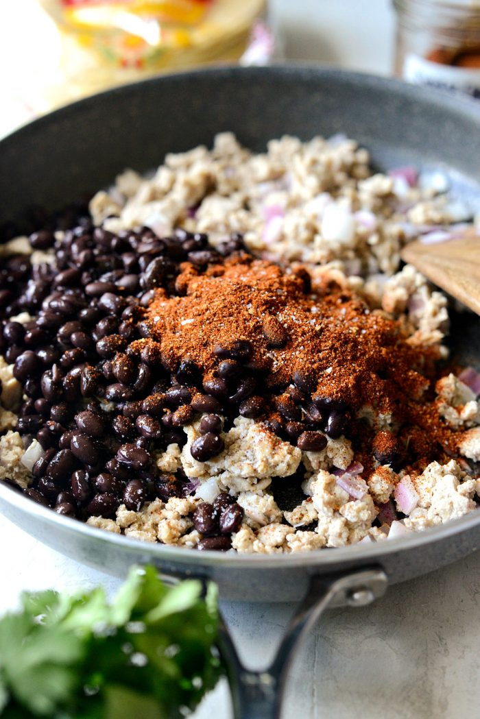black beans and chipotle seasoning added to skillet