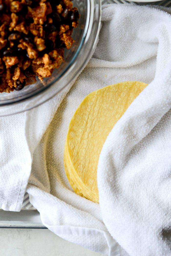 yellow corn tortillas warmed in damp towel