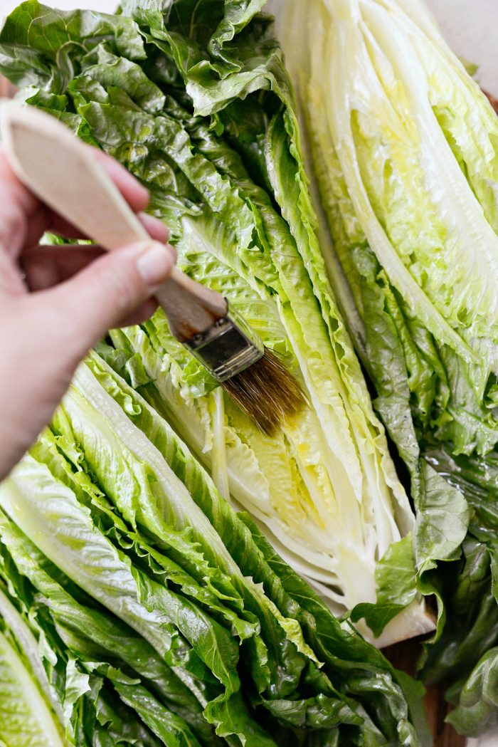 romaine lettuce brushed with roasted garlic olive oil